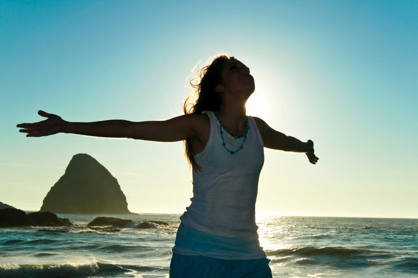 Woman with open arms and hands, face toward sky, a way to heal bad posture and depression
