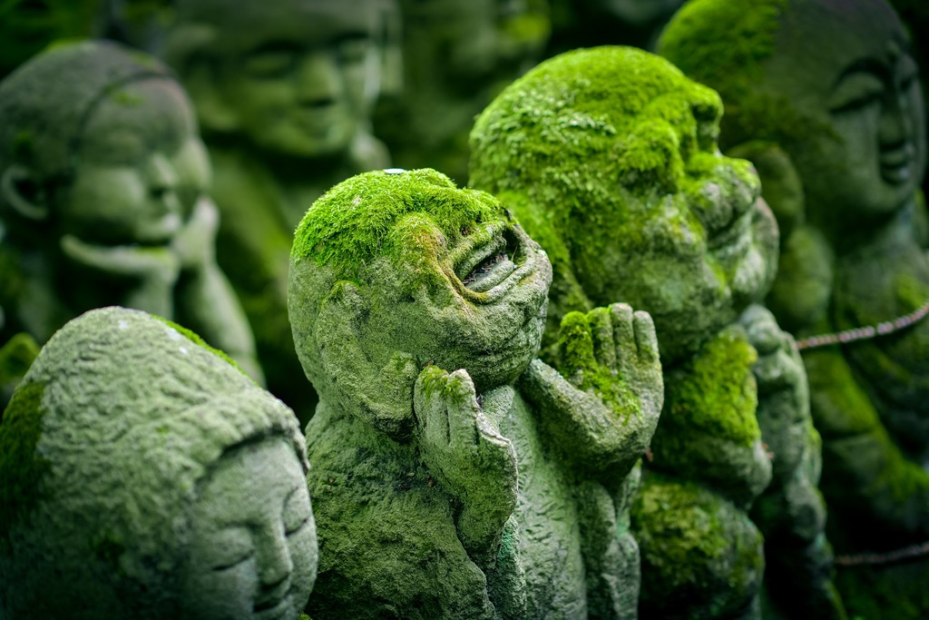 a japanese statue representing the healing of spiritual pain