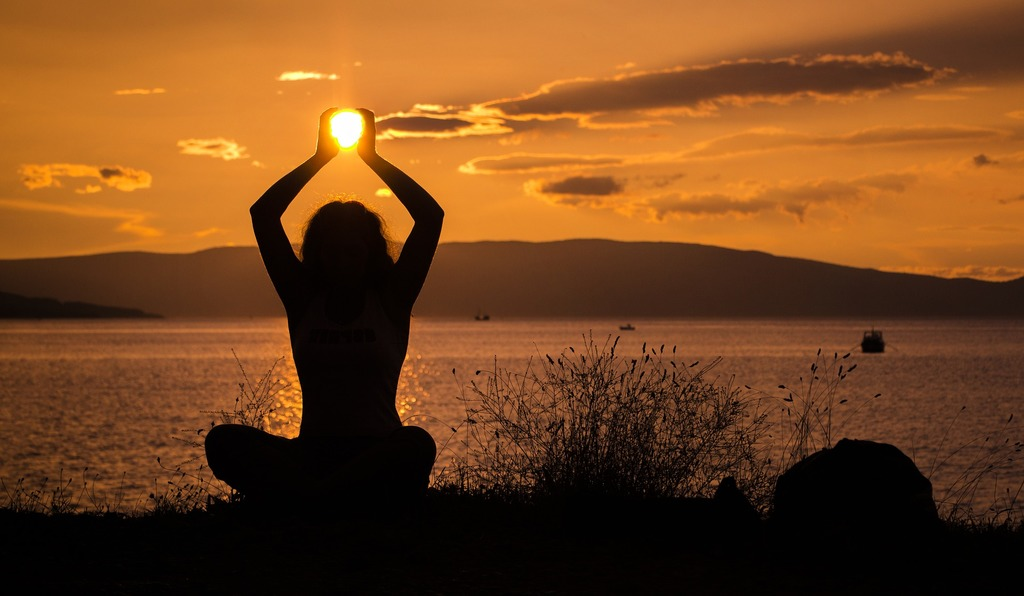 woman holding the sun, the source of life force energy