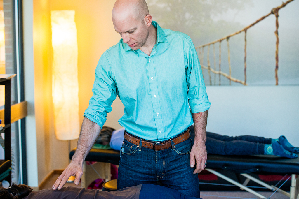 dr. jay offering energy healing at his office near boulder