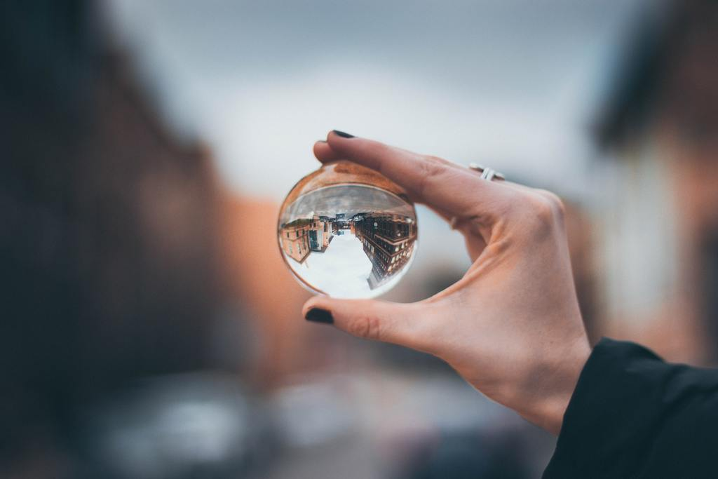 woman holding glass orb, perspective