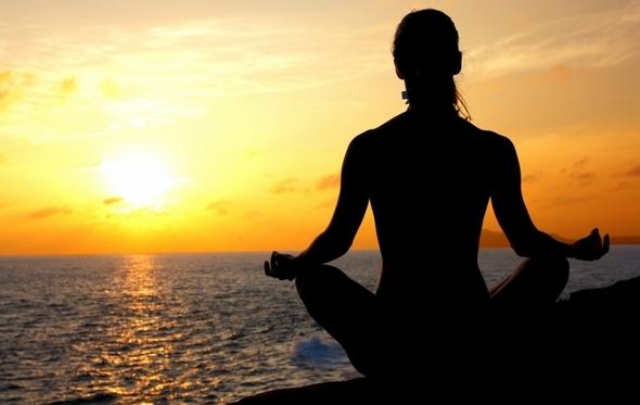 woman meditating increasing awareness