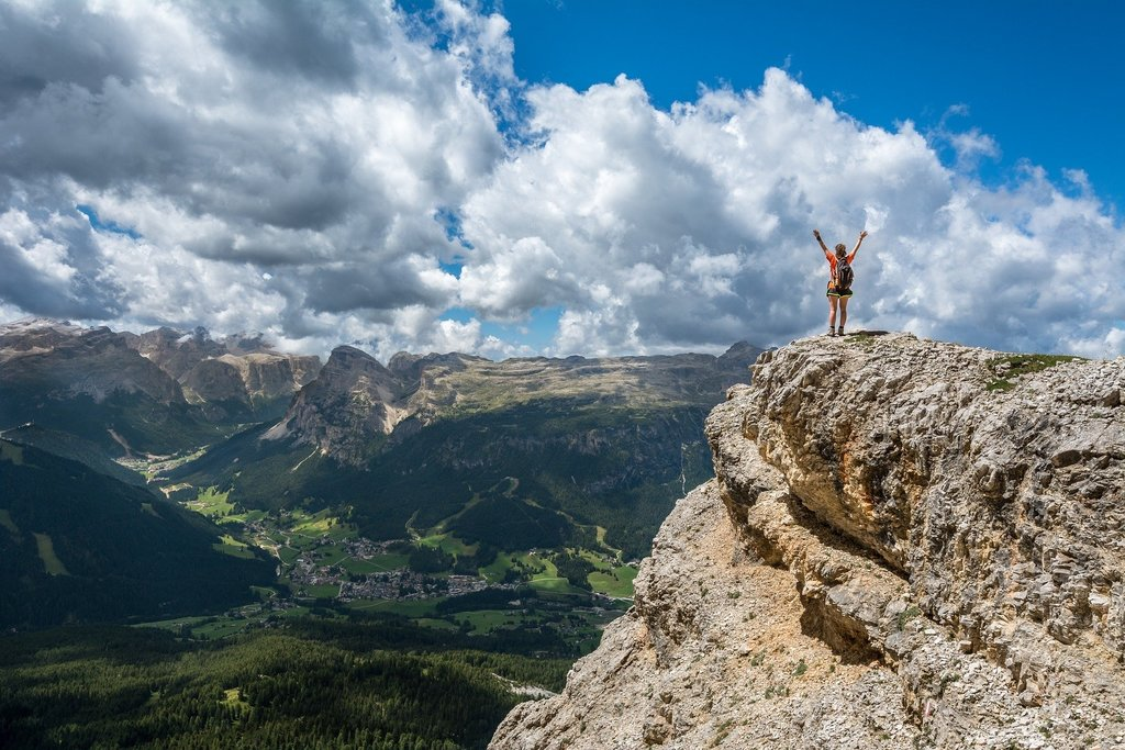 person on mountain, holistic healing